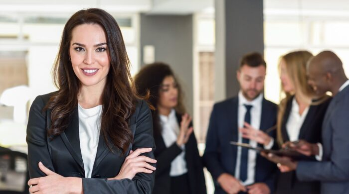Businesswoman leader in modern office with businesspeople