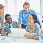 executives-joking-laughing-office