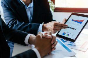 partner-business-man-investor-team-brainstorming-planning-about-financial-statistics-chart-information_33829-106
